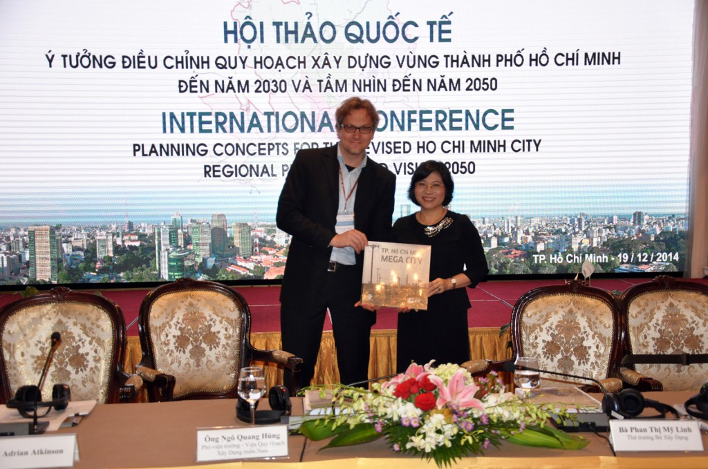 2014_12_19_HCMCR_Plan2030_Conference_Hand-Over_Ms.Linh_Vice-Minister_MoC